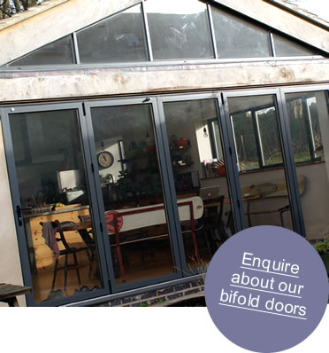 An aluminium bifold door with view onto patio area